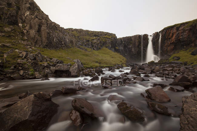 Surface level view of river flowing from waterfall, Seyoisfjorour, Iceland — Stock Photo