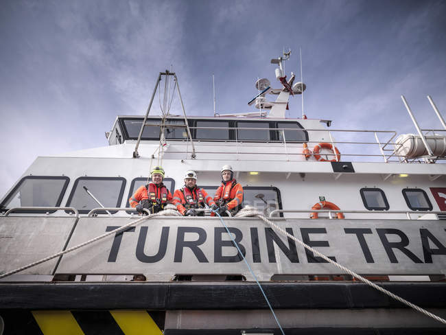 Portrait of  offshore windfarm engineers in port on ship — Stock Photo