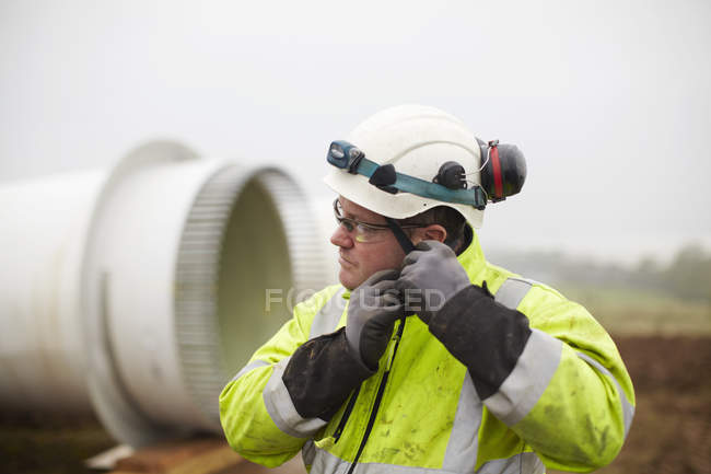 Engineer working at wind farm — Stock Photo
