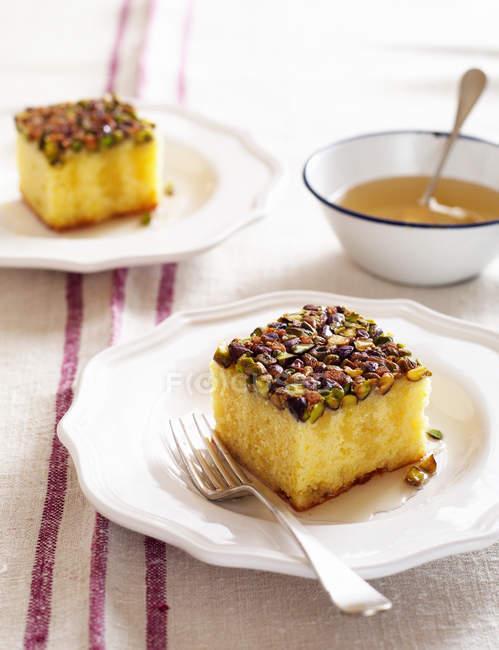 Фисташковый лимонный сироп торт — стоковое фото
