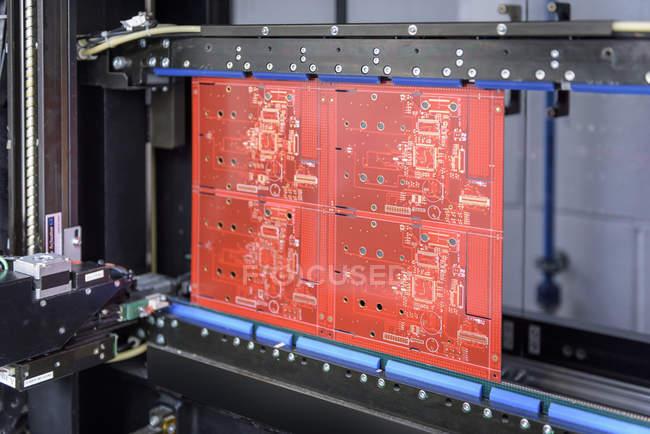 Circuit board in testing machine in circuit board factory — Stock Photo