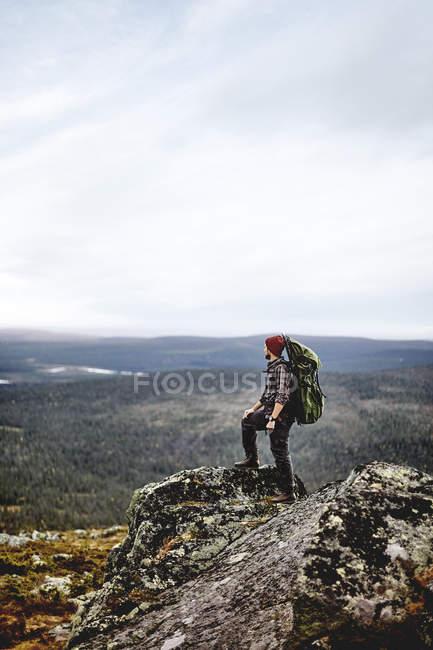 Sporty man overlooking landscape, Lapland, Finland — Stock Photo