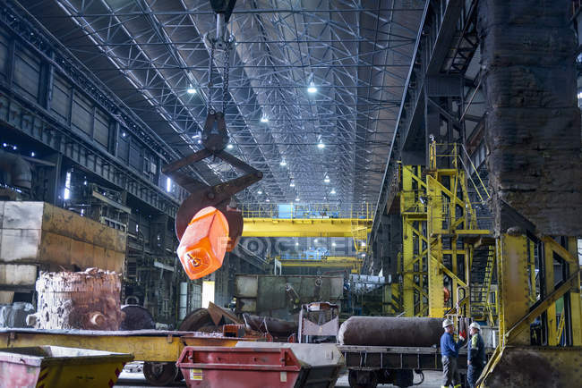 Red hot steel in industrial steelworks — Stock Photo