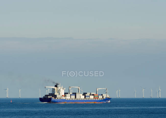 Container ship with windfarm in background — Stock Photo