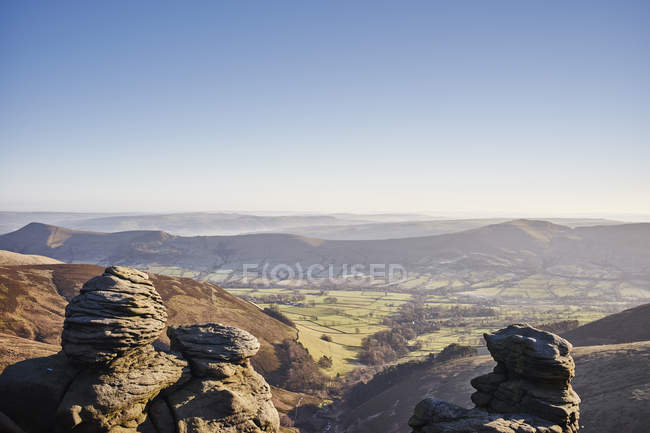 View of rock formations and valley in sunlight — Stock Photo