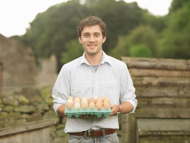 Farmer Holding A Tray Of Eggs — Stock Photo