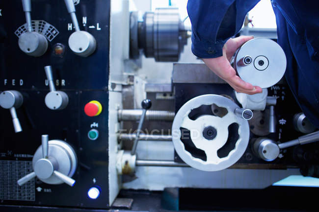 Cropped image of hand operating machinery — Stock Photo