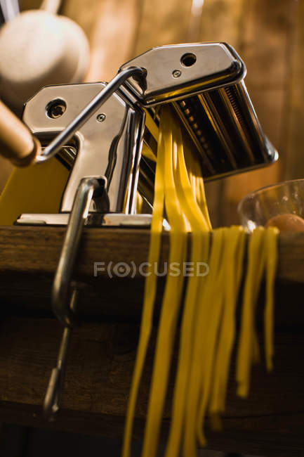 Low angle view of pasta machine on table — Stock Photo