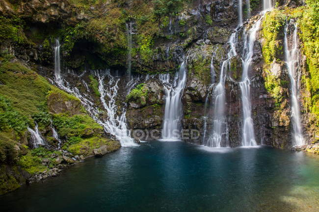 Rainforest waterfall flowing over rocks — Stock Photo