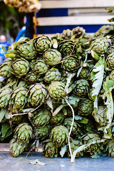 Stacked fresh artichokes — Stock Photo