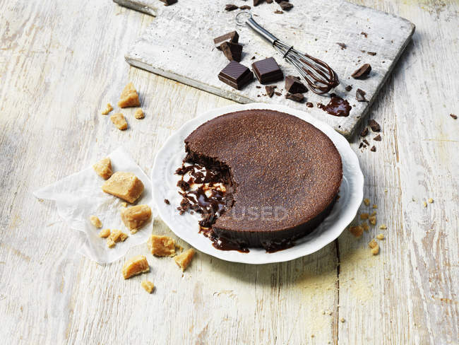 Eaten hot chocolate fudge pudding on messy table — Stock Photo