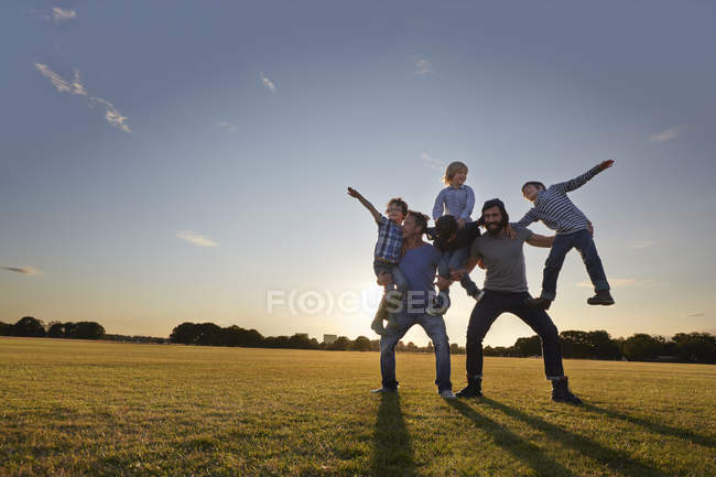 Family enjoying outdoor activity in park — Stock Photo
