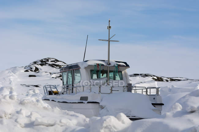 Snow covered boat at Ilulissat, Greenland — Stock Photo