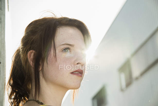 Portrait of sultry young woman on street — Stock Photo
