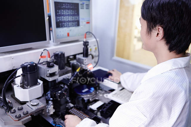 Young male technician working in LED factory in Guangdong, China — Stock Photo