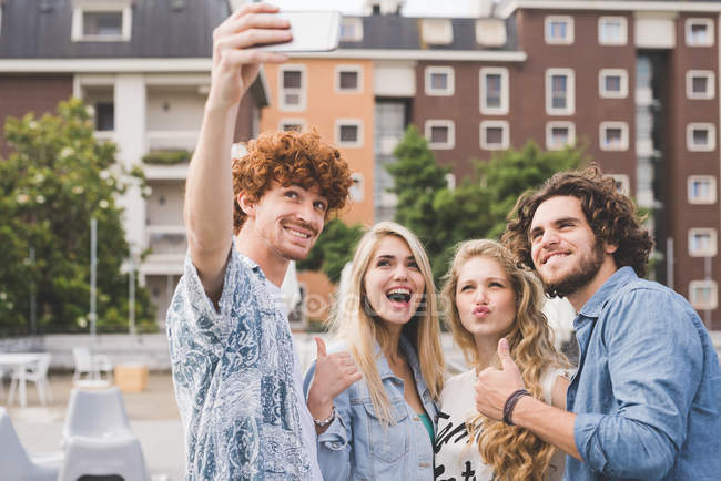 Friends taking selfie outdoors together — Stock Photo