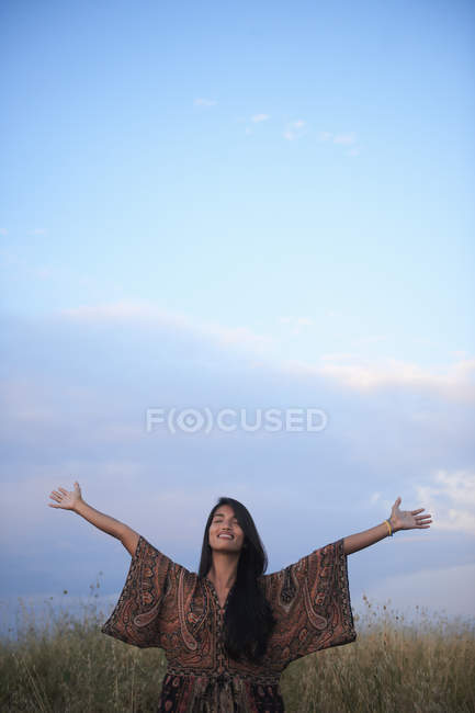 Woman enjoying fresh air with open arms — Stock Photo