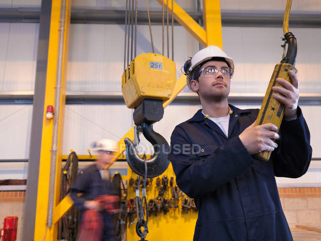 Engineer Controlling Crane at plant — Stock Photo