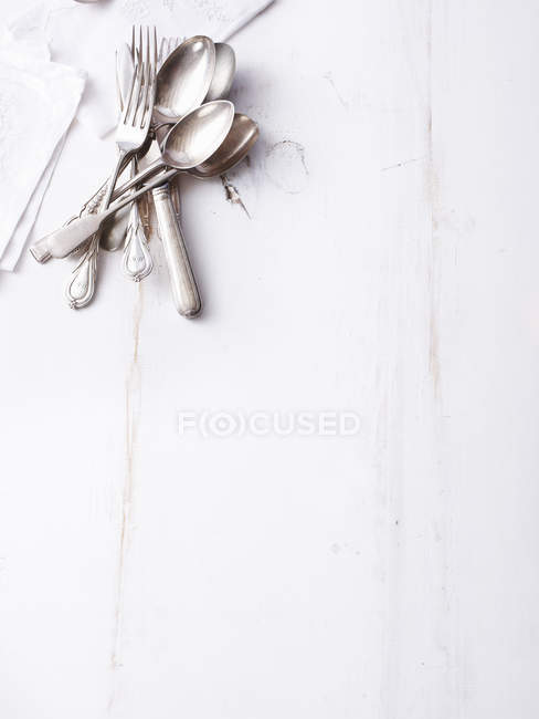 Still life of traditional cutlery on empty table — Stock Photo