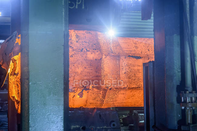 Hot steel in forging press in steelworks — Stock Photo
