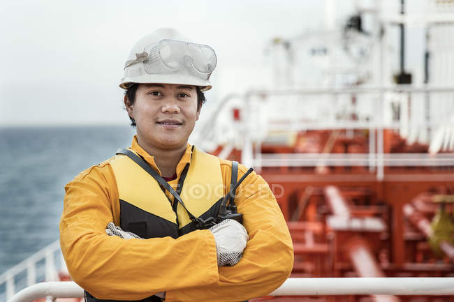 Portrait of worker on oil tanker in dock — Stock Photo