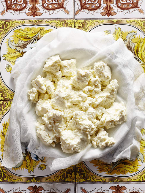 Top view of fresh homemade Italian ricotta in bowl — Stock Photo