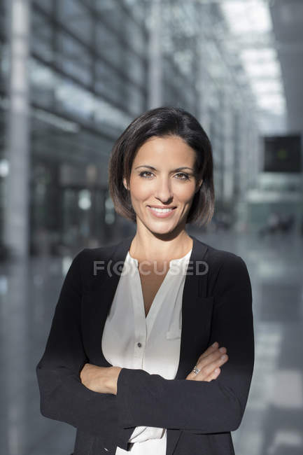 Portrait of mature businesswoman at airport — Stock Photo