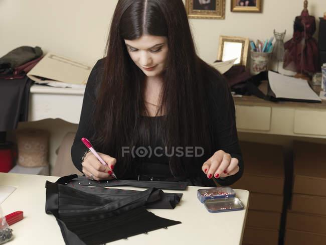 Corset maker working on design — Stock Photo