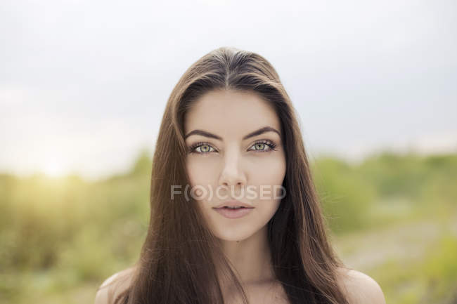 Bare shoulder portrait of beautiful young woman — Stock Photo