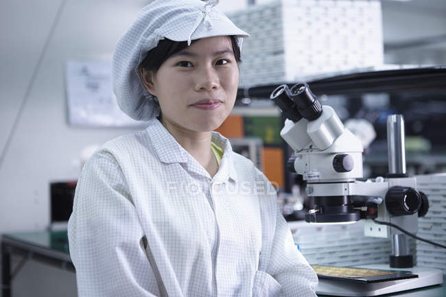 Portrait of worker in factory that specialises in creating functional circuits on flexible surfaces — Stock Photo