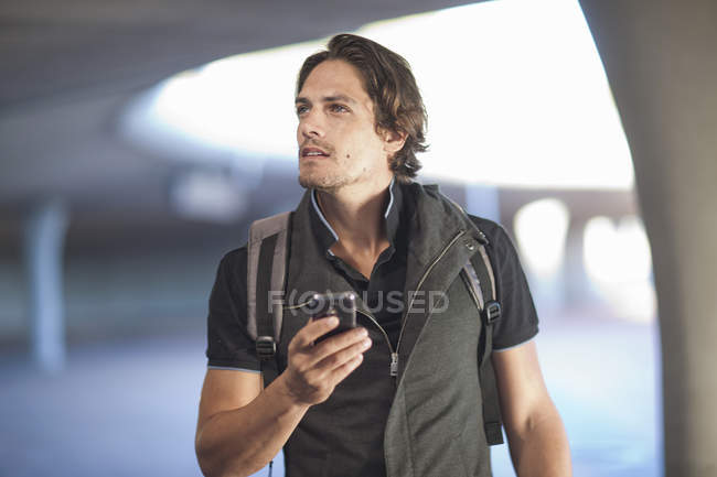Mid adult man navigating with smartphone in city — Stock Photo