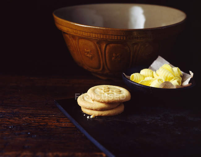 Homemade cookies with butter and mixing bowl — Stock Photo
