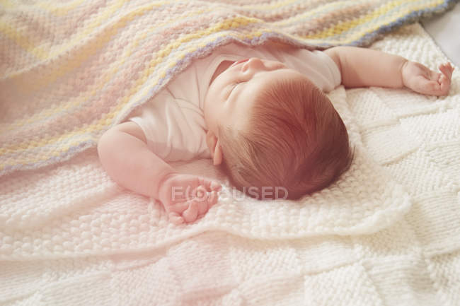 Close up of Baby sleeping in bed — Stock Photo