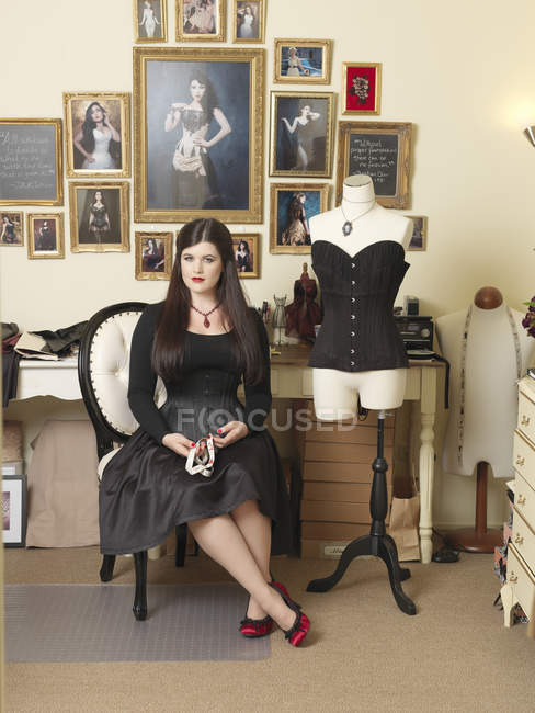 Corset maker and her finished product — Stock Photo