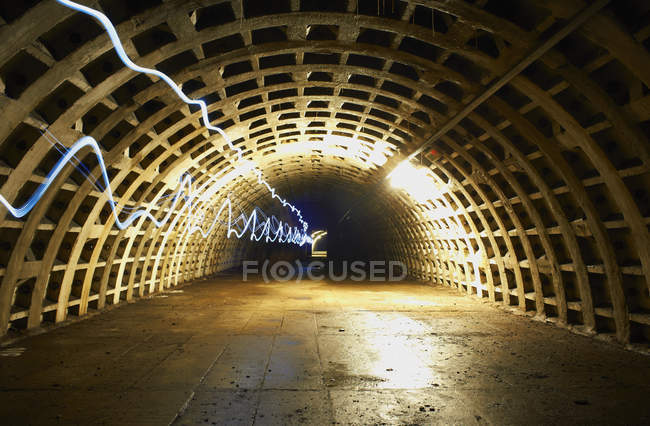 Long exposure shot light trails in tunnel — Stock Photo