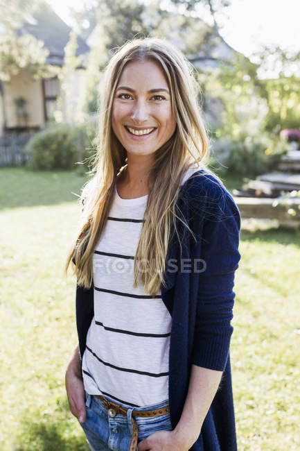 Mid adult woman smiling towards camera, portrait — Stock Photo