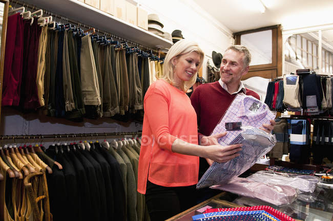 Couple browsing shirts in tailors shop — Stock Photo
