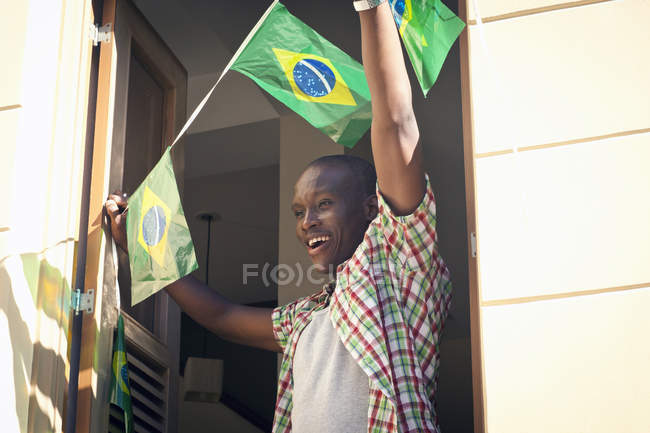 Students celebrating with Brazilian flags in the street, Rio de Janeiro, Brazil — Stock Photo