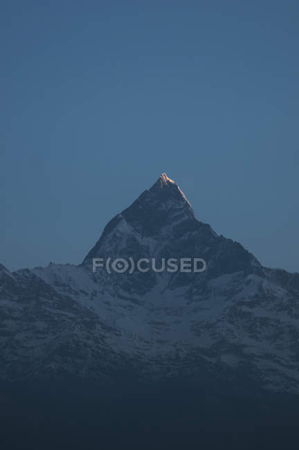 Scenic view of snowcapped mountain in darkness — Stock Photo
