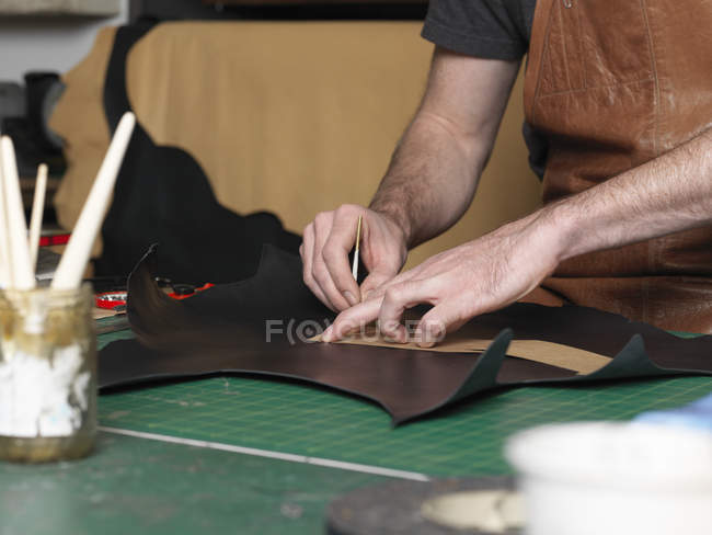 Shoemaker working in workshop, selective focus — Stock Photo