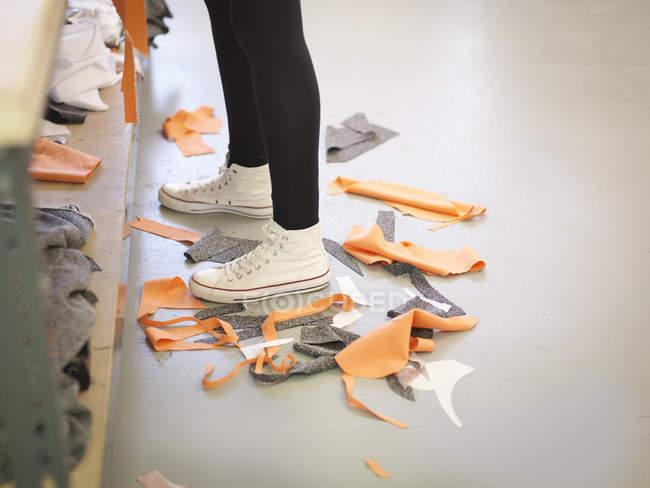 Off-cut material on floor in fashion design studio — Stock Photo