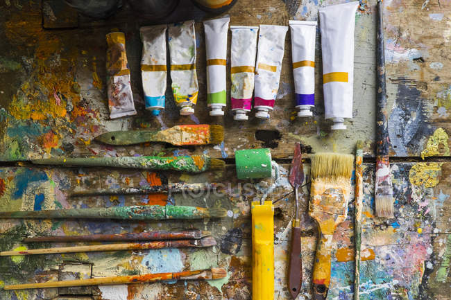 Artist materials, laid out on table, overhead view — Stock Photo