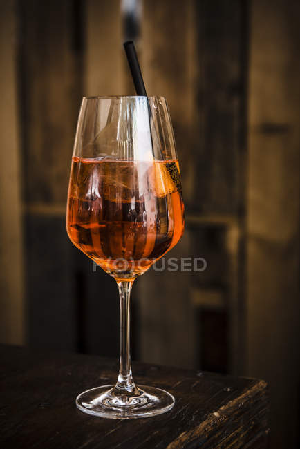 Glass of aperol spritz drink on table — Stock Photo