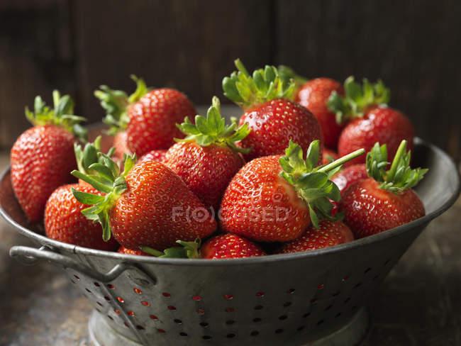 Fresh organic fruit, king strawberries in metal tray — Stock Photo