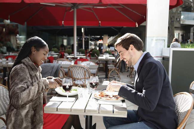 Couple enjoying meal at cafe, outdoors — Stock Photo