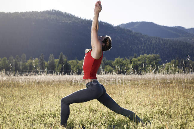 Young woman exercising in field, Missoula, Montana, USA — Stock Photo
