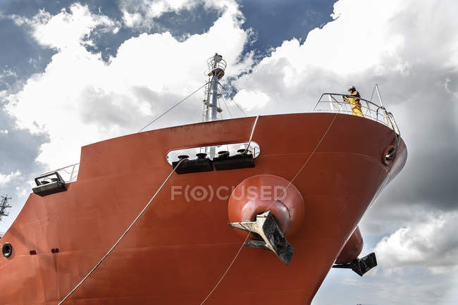 Low angle view of worker standing on board oil tanker — Stock Photo