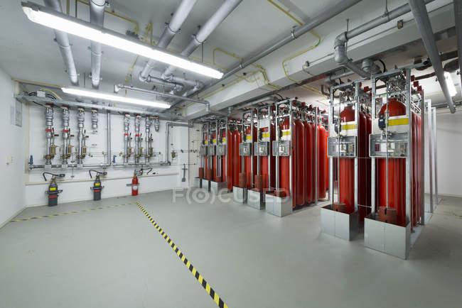 Fire extinguisher system, data storage in data warehouse — Stock Photo