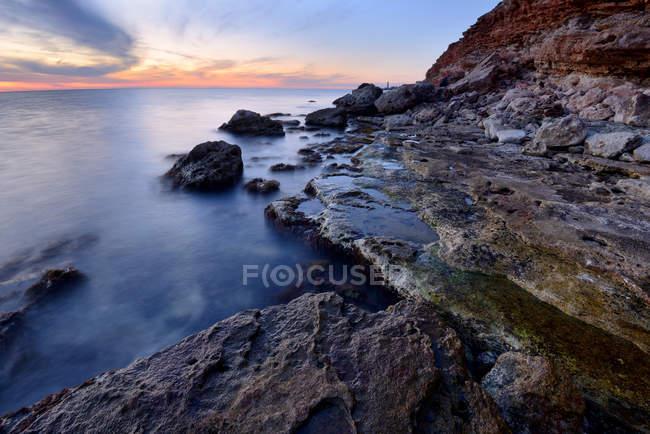 Long exposure shot of water and rocks at dusk, Crimea, Ukraine — Stock Photo