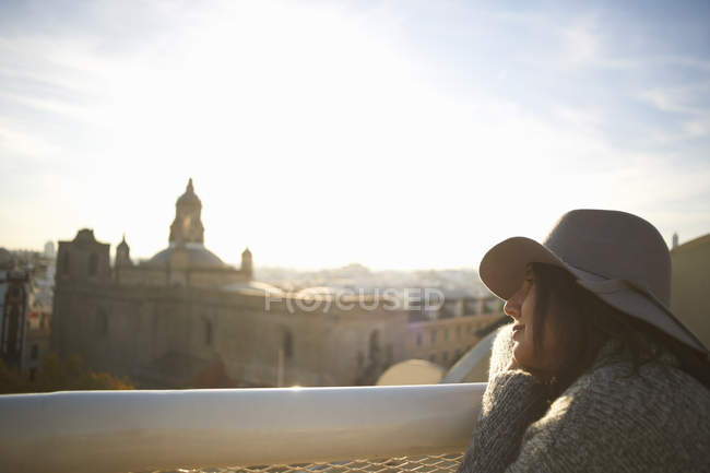 Woman enjoying view from terrace, Seville, Spain — Stock Photo